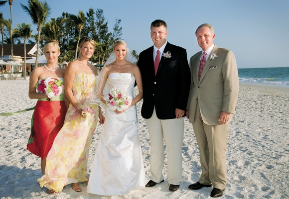 bride and family pose on Florida beach