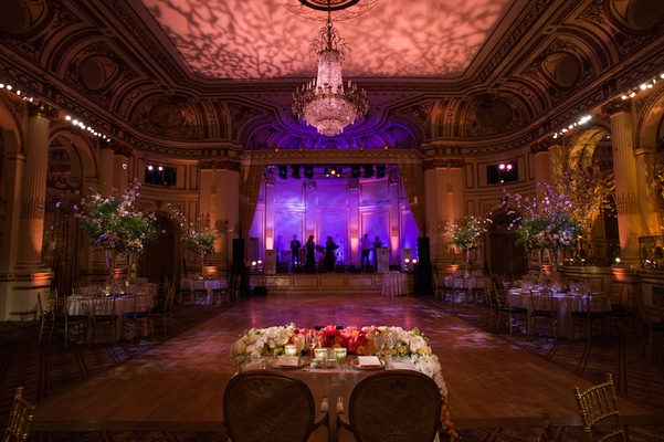 Sweetheart table with view of dance floor and stage