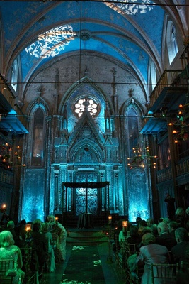 interior of gothic venue with blue lighting in cathedral ceiling