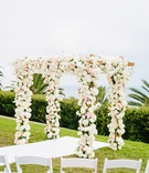 bel air bay club wedding, outdoor wedding ceremony on lawn, chuppah covered in flowers
