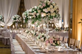 wedding reception long table clear acrylic chair linen high low centerpiece candelabra candlelight
