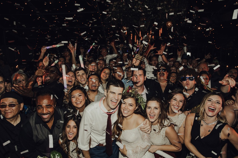 wedding guests at wedding reception confetti after party happy friends and family