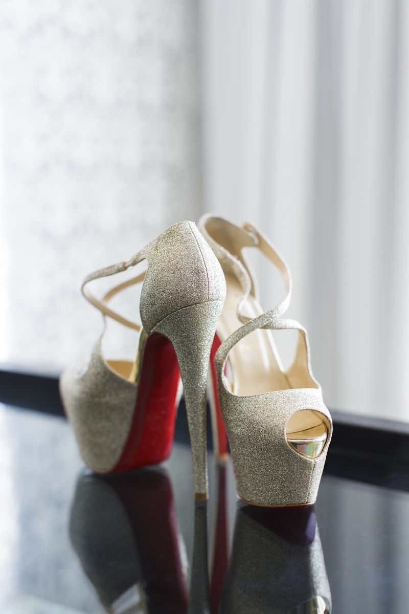 Silver platform Christian Louboutin heels with red soles