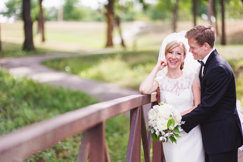 bride and groom photo on bridge