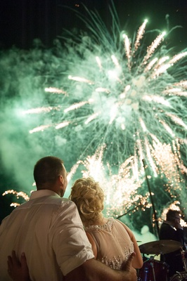 green and gold fireworks at destination wedding reception