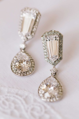 Halo diamond earrings with drop teardrop pendant and halo diamond design