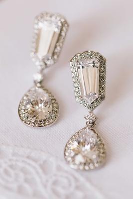 Halo diamond earrings with drop teardrop pendant and halo diamond design