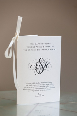 classic ceremony program with black printed monogram in the center
