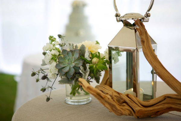 driftwood reception table décor foliage anemone white green lantern flowers