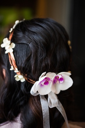 Bride wearing head wreath of twigs and orchids for wedding