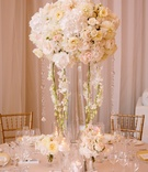 tall, flurry centerpiece of ivory blossoms with cascading crystals and orchids