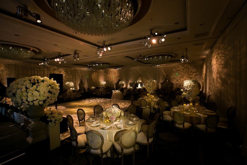 Beverly Hills ballroom reception with ivory and neutral decorations