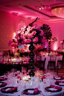 White sequin table with black orb vase and pink flowers