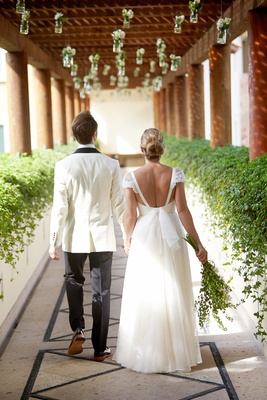 Low back wedding dress with bow and lace cap sleeves