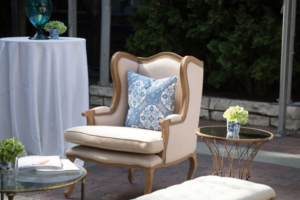 beige seating, southern inspired wedding tan armchair blue and white pillow