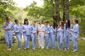 bride in white pajama set, bridesmaids in periwinkle blue pajama set in forest