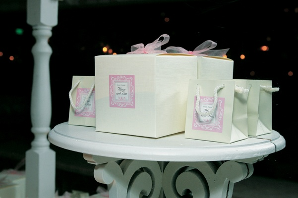 White and pale pink gifts for wedding guests