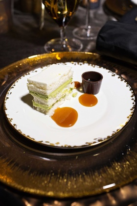Slice of green tea flavored wedding cake with caramel sauce at wedding reception