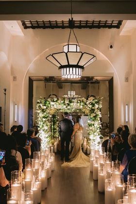 wedding ceremony hotel figueroa candles lining aisle greenery white flower chuppah