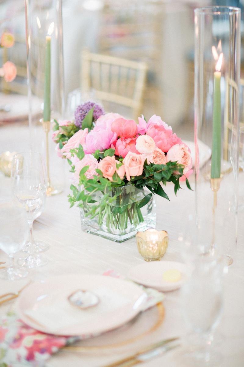 wedding reception table setting flower print napkin light pink purple coral flower centerpiece taper