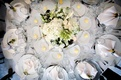 all white table decorated with bouquet of greenery