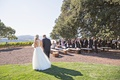 Bride in wedding dress from Bella Bianca with father of bride two trees outdoor vineyard winery