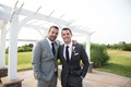 John Colaneri and Anthony Carino, Hosts of Kitchen Cousins, in grey suits at John's wedding