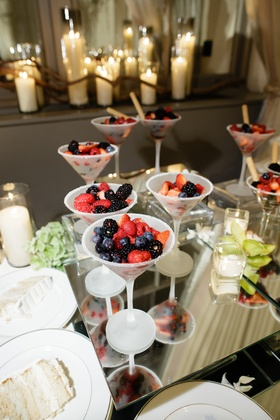 Sugar-rimmed martini glass filled with berries