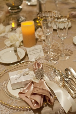 Sparkling napkin ring on beaded charger plates