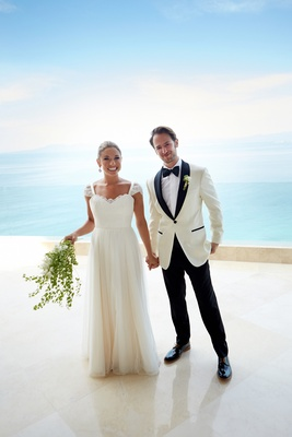 Bride and groom in front of ocean at destination wedding