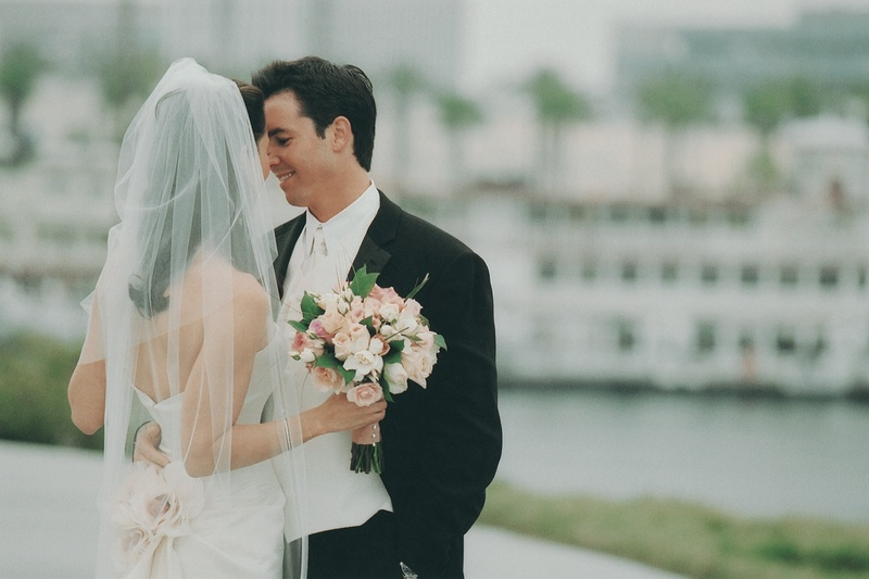 Janet Evans and her groom by dock on wedding day