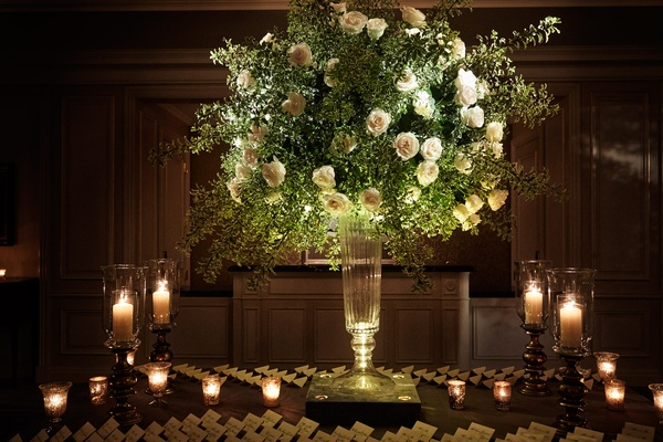 Reception escort card table candle light white rose escort cards pillar candles and votives