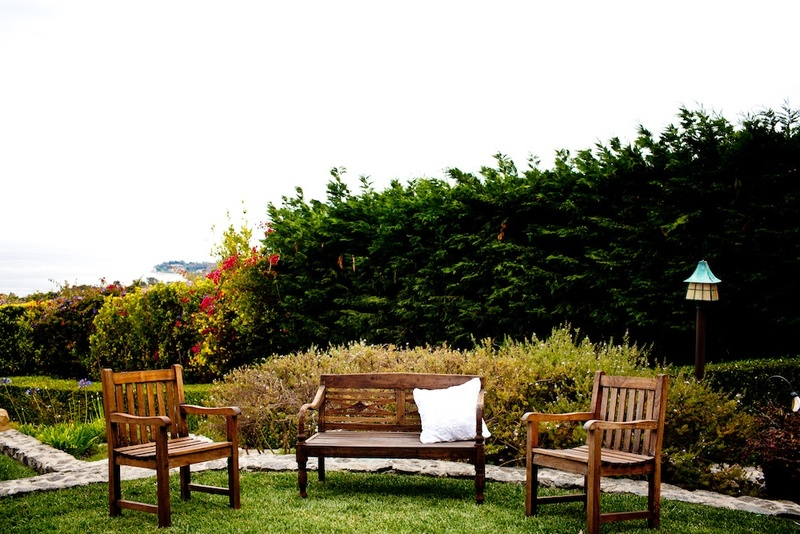 Malibu wedding wood lounge chair and bench area