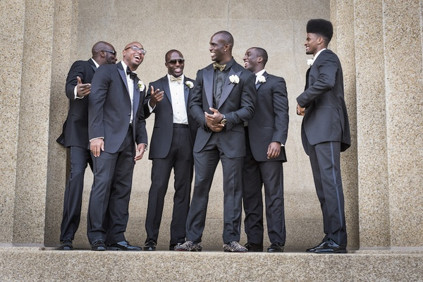 Tennessee Titan in black tuxedo with New England Patriot Devin McCourty and groomsmen