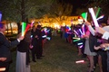 Wedding guests holding light sticks outside