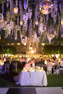 Wedding reception on the lawn of the Arizona Biltmore with candlelight and purple lighting