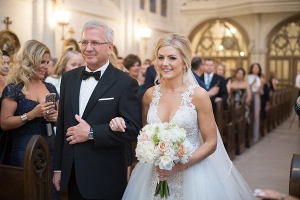 bride in wedding dress with overskirt with father razny jewelers family wedding ceremony church