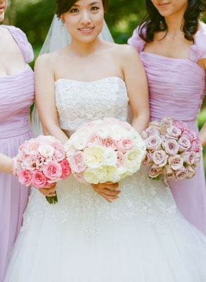 bride and bridesmaid bouquets in different shades of pink