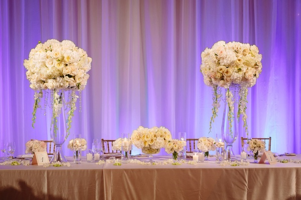 wedding head table two centerpieces with small centerpiece in the middle