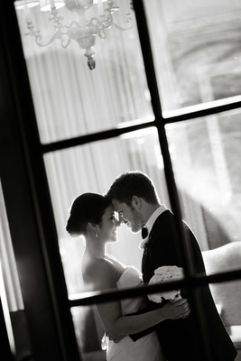 Black and white photo of couple embracing
