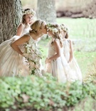 Keri Lynn Pratt kisses flower girls' nose in forest