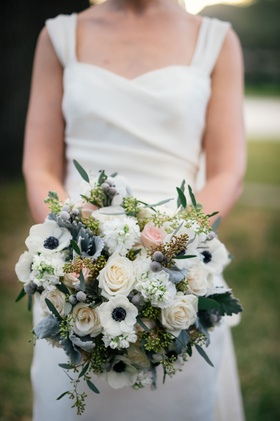 Winter Bridal Bouquet white anemone flowers with blue centers, brunia balls, pink and white roses
