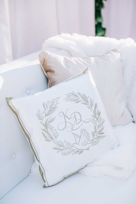 white and gold pillow custom design monogram gold border fur throw tufted lounge area