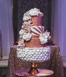 four tier alternating white copper cake styled shoot wedding flowers metallic details intricate