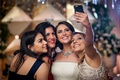 bride friends taking selfie wedding reception fun bridesmaids social media iphone technology