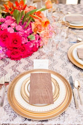 bold tablescape metallic wood details pink purple orange gold wedding styled shoot reception