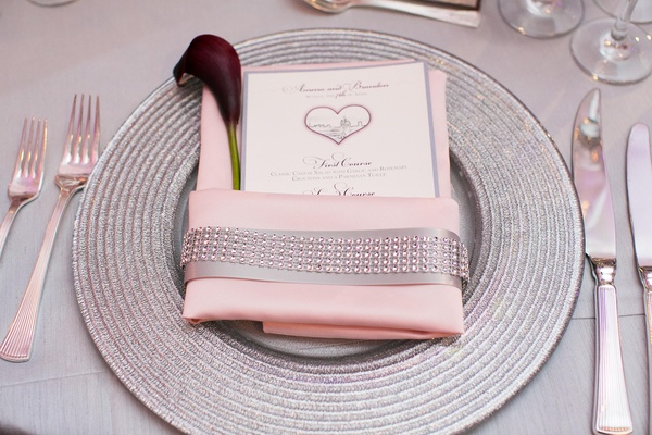 Grey-bordered menu card in pink napkin
