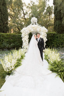 Bride in marchesa couture wedding dress groom in suit at beverly hills hotel wedding outdoor garden