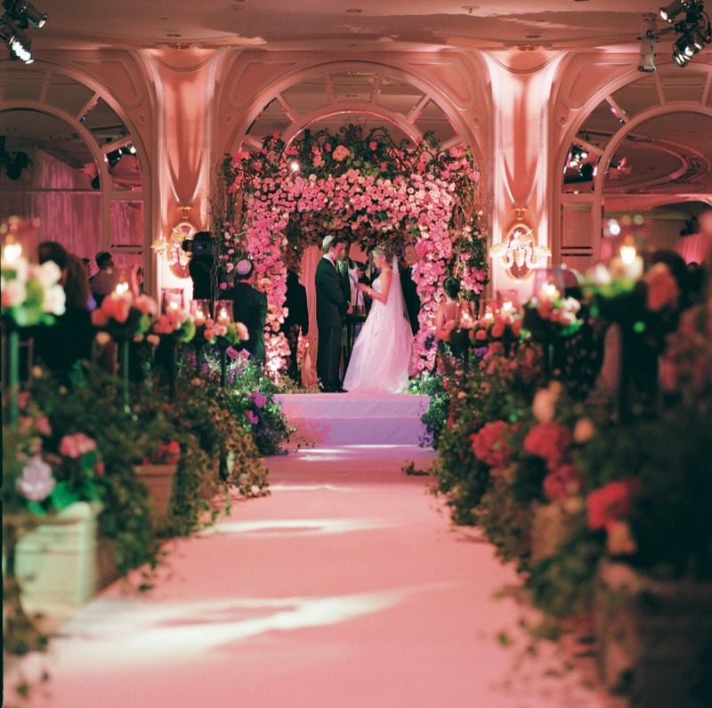 Flowers lined aisleway leading to altar