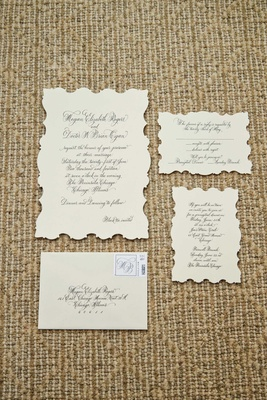 vintage inspired wedding invitations with black calligraphy decorated edges
